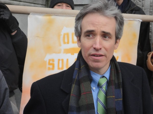 John Branson, attorney for OccupyMaine, fields questions from reporters Monday during a news conference held outside the Cumberland County Courthouse. Branson filed a lawsuit against the city of Portland on behalf of OccupyMaine on Monday.