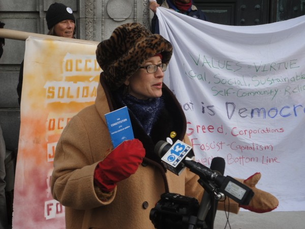 Heather Curtis, one of four OccupyMaine members to join a lawsuit against the city of Portland filed Monday, speaks to reporters outside the Cumberland County Courthouse.