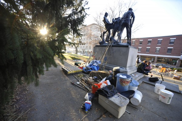Some of Occupy Bangor's encampment supplies were seen behind the Peirce Park monument early Monday morning, Dec. 5, 2011.