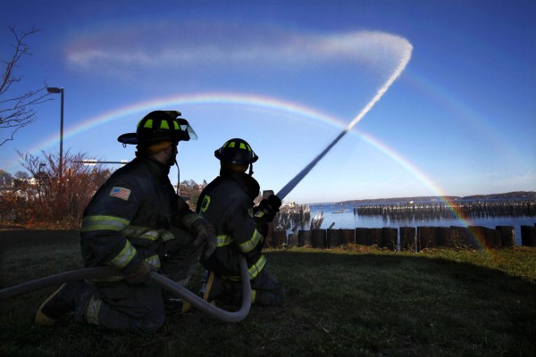 Rob White, left, and Adam Kalaowsky create a rainbow while practicing with a fire hose during a firefighter training session on the Portland waterfront on Nov. 7. I came across this session on a day off. Before leaving I had made arrangements to spend more time shooting future training sessions for a complete essay but for one reason or another I wasn't able to follow up.