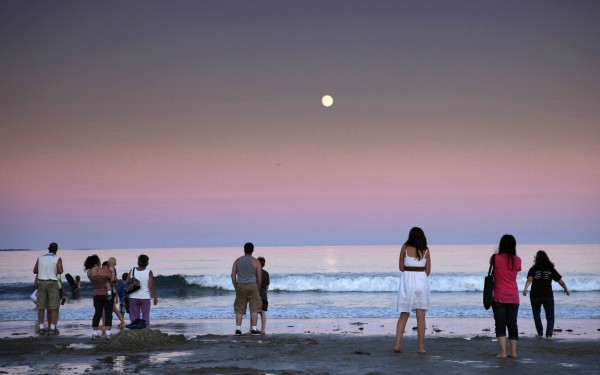 Beachgoers watch a full moon rise at Old Orchard Beach. Although I like this image, other moonrise photos that included landmarks were picked for the dusk till dawn essay on Old Orchard.