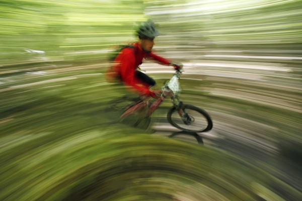 A 1/5 of a second exposure and a 14-millimeter lens were used to convey motion in this picture made of during a mountain bike race at Bradbury Mountain State Park on Sept. 17.