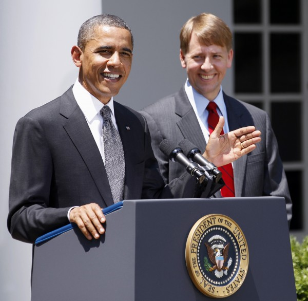 President Barack Obama and presidential nominee to serve as the first director of the Consumer Financial Protection Bureau, former Ohio Attorney General Richard Cordray are seen in the Rose Garden of the White House in Washington in July 2011.
