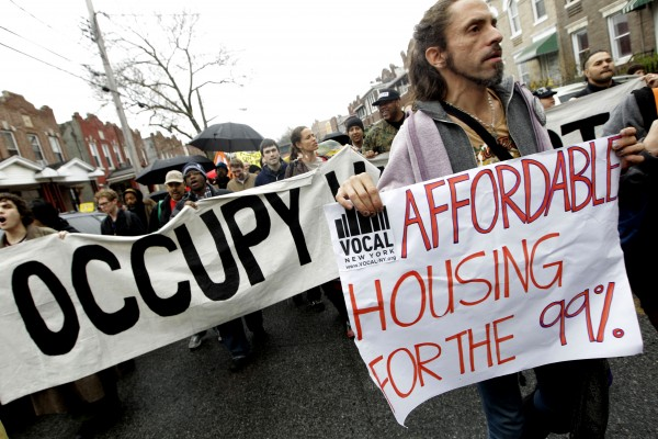 Occupy Wall Street activists march during a tour of foreclosed homes in the East New York neighborhood of the Brooklyn borough of New York, Tuesday, Dec. 6, 2011.