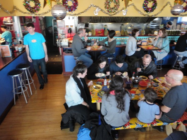 Diners and servers bustle about El Rayo Taqueria on York Street in Portland Wednesday. The Mexican restaurant is one of four in the city taking part in the &quotCalories Count Lunch&quot on Jan. 3, when menu items will be priced according to their calorie amounts.