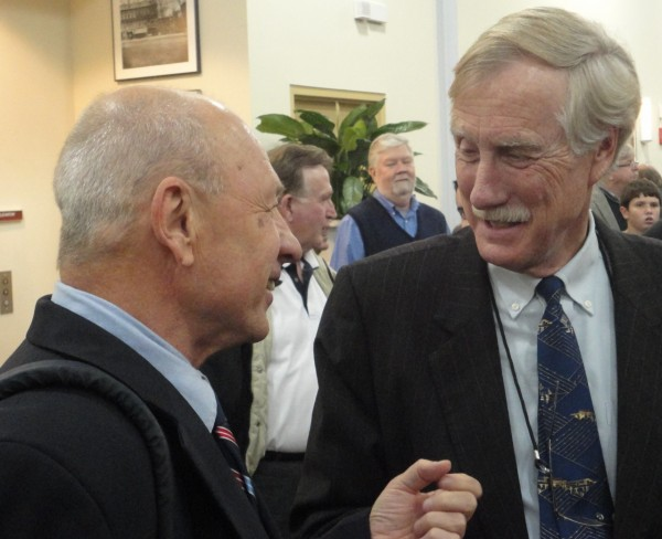 New Portland Mayor Michael Brennan chats with former Gov. Angus King as the crowd settles in Monday night for the inaugural gala at the Ocean Gateway Terminal's event hall.