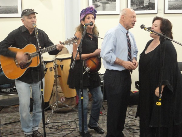 New Portland Mayor Michael Brennan, second from right, sings &quotSea Cruise&quot with the folk blues band Chipped Enamel during Monday night's inaugural event.