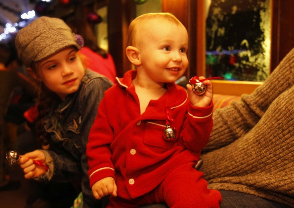 Kason Mercier, 16 months, of Standish rings sleigh bells that are given as gifts to young riders on the Polar Express at the Narrow Gauge Railroad in Portland.