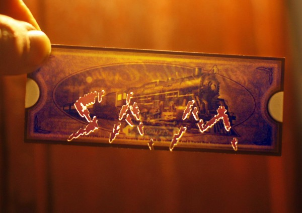 The famous golden ticket bearing the conductor's handiwork with a ticket punch became a keepsake for a rider named Sam on the Polar Express in Portland.