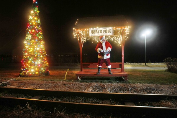 Santa awaits the arrival of the Polar Express at the &quotNorth Pole&quot on the Narrow Gauge Railroad in Portland.