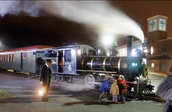 Conductor Brian Durham chats with youngsters at the Polar Express at the Narrow Gauge Railroad at Ocean Gateway in Portland.