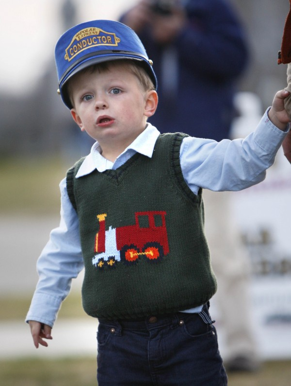 Young train buff Mason Tyler, 3, of Weld, watches the Polar Express arrive at the Narrow Gauge Railroad in Portland.