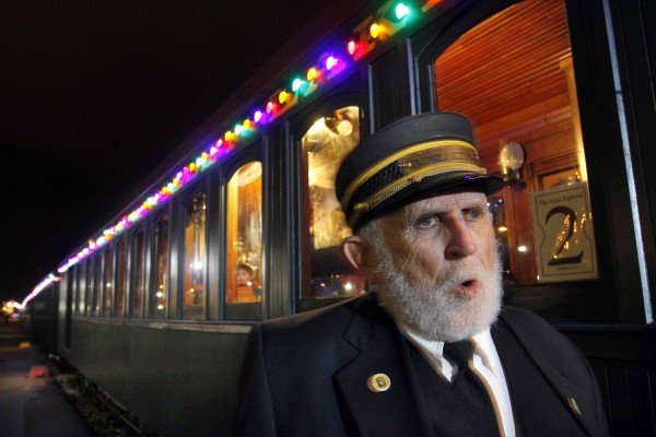 Conductor Arthur Hussey bellows &quotAll aboard!&quot as the 5:15 Polar Express prepares to leave Ocean Gateway depot for a journey to the &quotNorth Pole.&quot