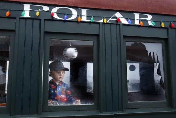 Oscar Gallant, 2, of Woolwich, takes in the view while riding the Polar Express at the Narrow Gauge Railroad in Portland.
