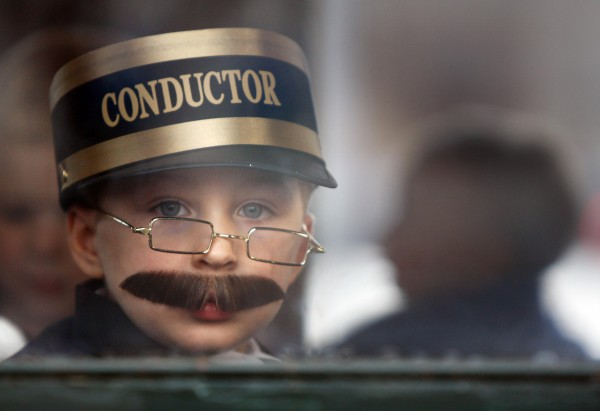 Ethan Pearson, 4, of Casco, wears his conductor's costume, complete with mustache, while riding the Polar Express on the Narrow Gauge Railroad in Portland.