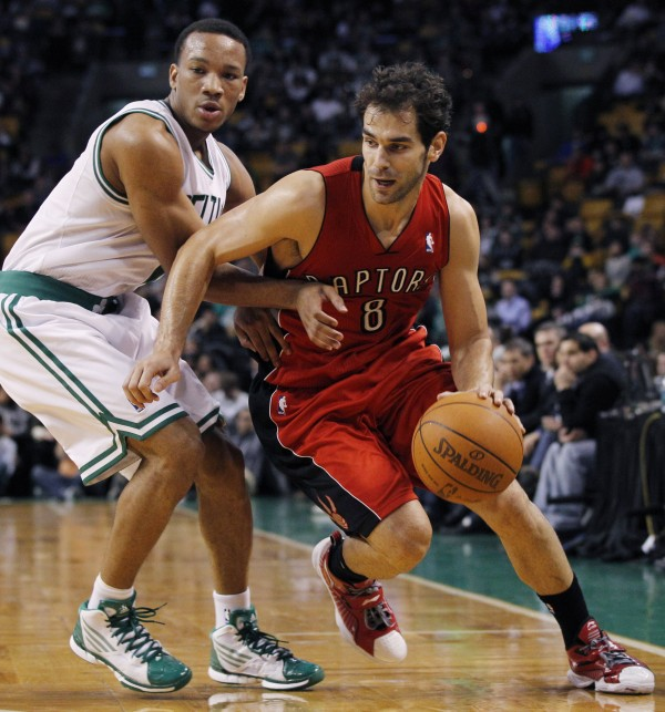 Toronto Raptors guard Jose Calderon (8) drives around Boston Celtics guard Avery Bradley during the second half of an NBA preseason basketball game in Boston, Wednesday, Dec. 21, 2011.