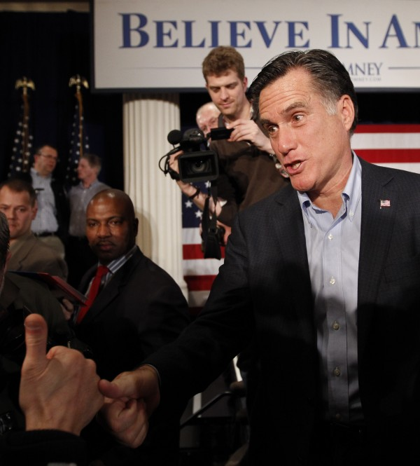 Republican presidential candidate and former Massachusetts Gov. Mitt Romney greets supporters after a campaign stop in Davenport, Iowa, Tuesday, Dec. 27, 2011.