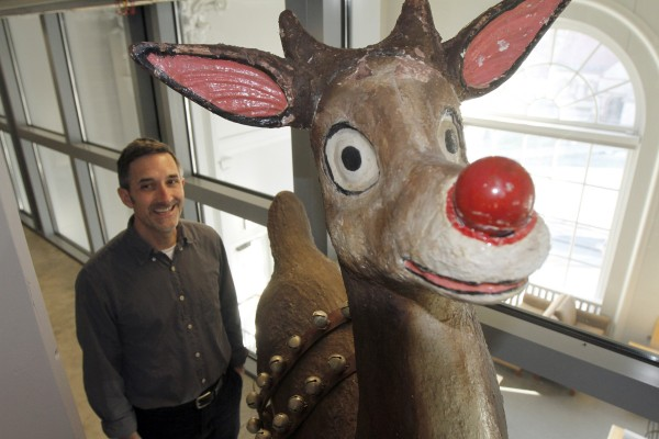 Peter Carini stands next to a full-size Rudolph the Red-Nosed Reindeer, part of a special collection at Dartmouth College, on Tuesday, Dec. 20, 2011 in Hanover, N.H.