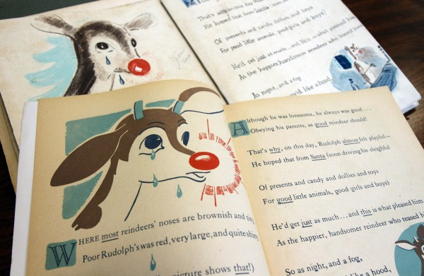 A  first edition of &quotRudolph, the Red-Nosed Reindeer&quot (bottom) and an original layout (top), part of a special collection at Dartmouth College, are displayed on Tuesday, Dec. 20, 2011 in Hanover, N.H.