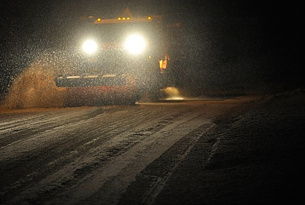 A Bangor Public Works plow is nearly obscured by the white stuff as it travels Essex Street in Bangor before daybreak Friday.