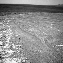 12-mile-high dust devil photographed on surface of Mars