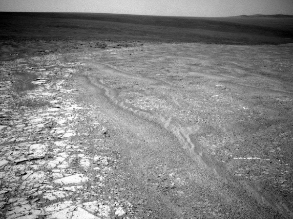 This image provided by NASA shows a fragment along the rim of Endeavour Crater where the Mars rover Opportunity has been exploring since August. With Martian winter approaching, Opportunity has been in search of a spot to spend the winter.