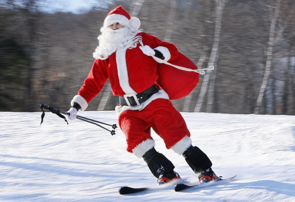 One of the 250 Santas participating in a fundraising event takes a run at Sunday River Ski Resort on Sunday, Dec. 4, 2011, in Newry, Maine. To qualify for a free lift ticket each Santa had to wear a full red Santa costume, complete with beard,  and donate at least $10 to the Bethel Rotary Club's annual drive to provide gifts for the area's needy children.