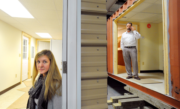 Chad Walton (right), owner of SnapSpace Solutions in Brewer, and his daughter Kelsey Walton, the vice president show off a shipping container home Wednesday, Dec. 7, 2011. The company is getting ready to ship out a third of the converted container buildings they made.