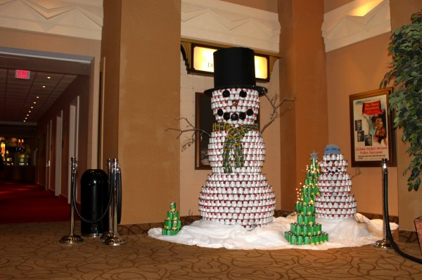 The snowman made of stacks of canned goods, on display at Hollywood Slots in Bangor, is the work of artist Allison Melton. In January the canned goods will be donated to the United Way Pantry Project.