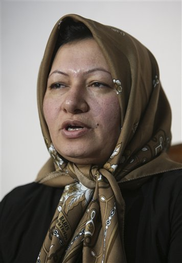 In this Jan. 1, 2011 file photo, Iranian Sakineh Mohammadi Ashtiani, who has been sentenced to death by stoning for adultery, speaks to the media in a news briefing, in the northwestern city of Tabriz, Iran. On Sunday, Dec. 25, 2011, a local judiciary official says Ashtiani will be executed either by stoning or hanging.
