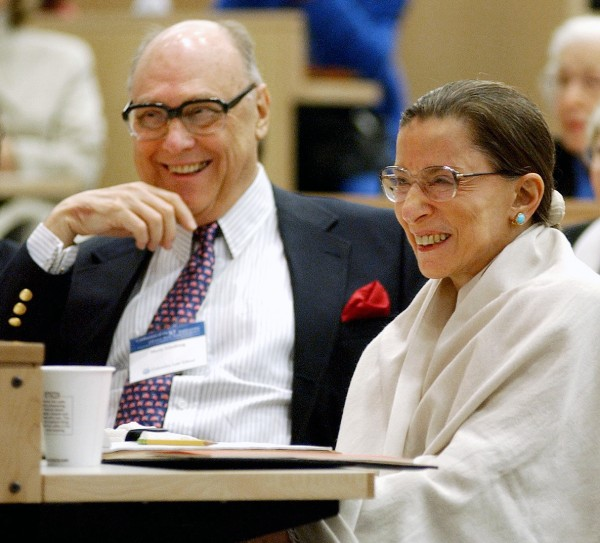 "In this Sept. 12, 2003, file photo, Supreme Court Justice Ruth Bader Ginsburg and her husband, Martin, laugh as they listen to Justice Stephen Breyer speak at Columbia Law School in New York. The cookbook ""Chef Supreme"" published in Dec. 2011, and contains nearly 50 of the late Martin Ginsburg''s recipes."