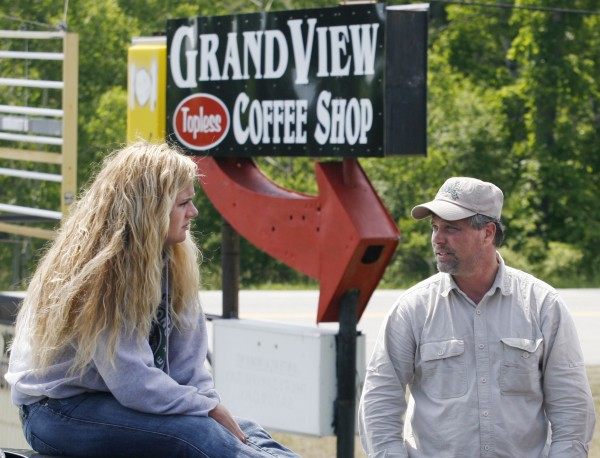 Donald Crabtree (right), owner of the Grand View Topless Coffee Shop, speaks with Krista MacIntyre, a waitress at the coffee shop, as they sit outside of the shop Wednesday, June 3, 2009, in Vassalboro, Maine.