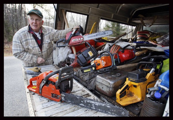 A collection of chain saws of various sizes fill the back of Bob Doyle's truck. He estimates he owns about 10.