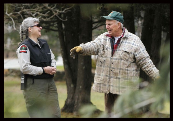 Forest Ranger Sue Myers chats with Bob Doyle after he finished cutting down a tree in Winthrop earlier this month. &quotI'm a member of the Bob Doyle Fan Club,&quot joked Myers, who stopped by to watch the pro at work.