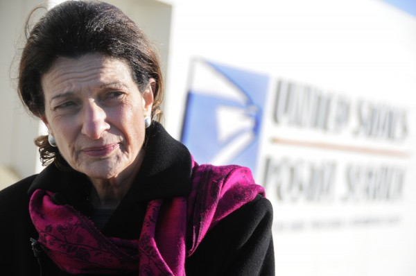 U.S. Senator Olympia J. Snowe, R-Maine, talks with the media at the U.S. Postal Service Eastern Maine Processing and Distribution Facility in Hampden on Tuesday, Dec. 20, 2011. Afterwards, Sen. Snowe toured the facility and met with employees.