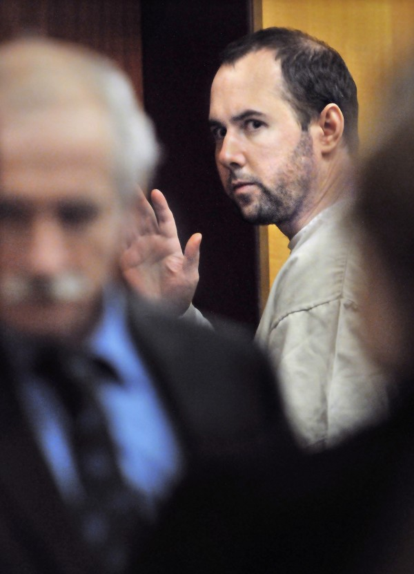 Stephen Morgan of Marblehead, Mass., waves to his family at state court in Middletown, Conn., recently.