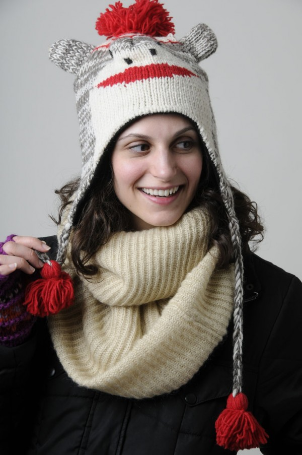 Knit, fleece-lined sock monkey hat by Mexicali Blues from Mexicali Blues in Bangor: $18. Knit, fleece-lined glittens by Mexicali Blues from Mexicali Blues in Bangor: $14.  Infinity scarf of acrylic, nylon and mohair by Ralph Lauren from Best Bib and Tucker in Bangor: $44. Model: Kat Johnson.