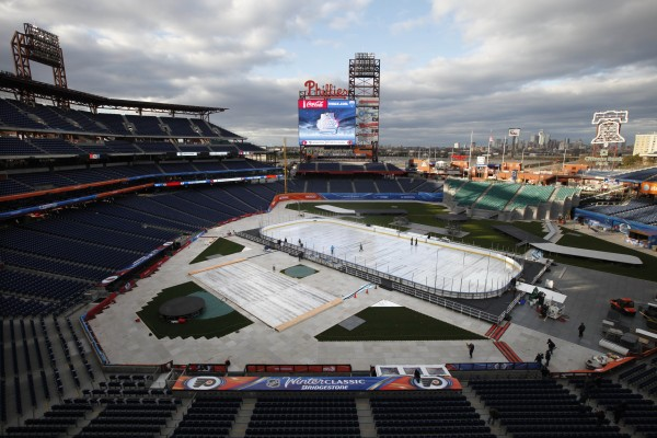 Crews work on the ice rink in preparation for NHL hockey's Winter Classic at Citizens Bank Park, Wednesday, Dec. 28, 2011, in Philadelphia.