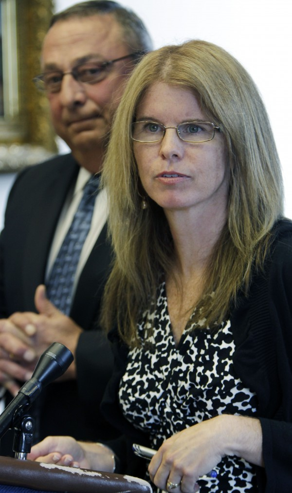 Health and Human Services Commissioner Mary  Mayhew, along with Gov. Paul LePage, answers questions at a news conference where the department came under scrutiny after a person released a video at the State House in Augusta, Maine, on Thursday, Aug. 11, 2011.  LePage says the video doesn't show someone trying to defraud the system, but it points to a need for better staff training.