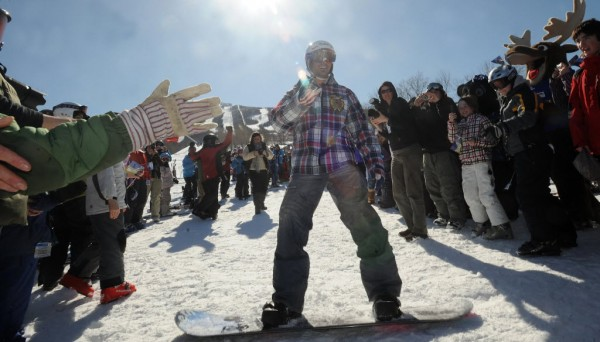 Two time Olympic gold medalist Seth Wescott is awaited by a crowd of people gathered to see him as he arrives to his homecoming celebration on a snowboard in this 2010 file photo.