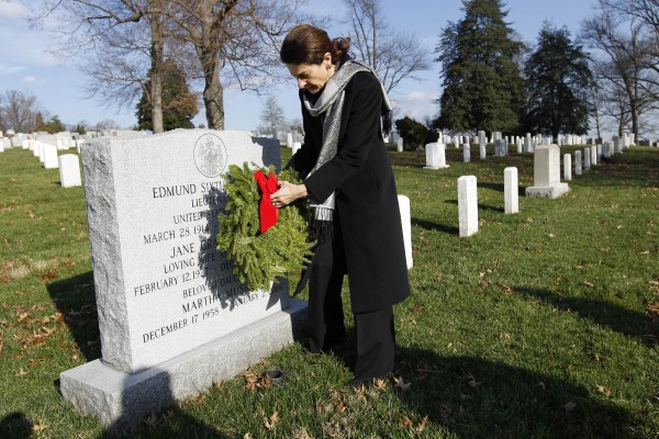 Sen. Olympia Snowe, R-Maine, lays a holiday wreath over the grave of Lt. Edmund Muskie at Arlington National Cemetery in Washington on Saturday Dec. 10, 2011, during Wreaths Across America Day.