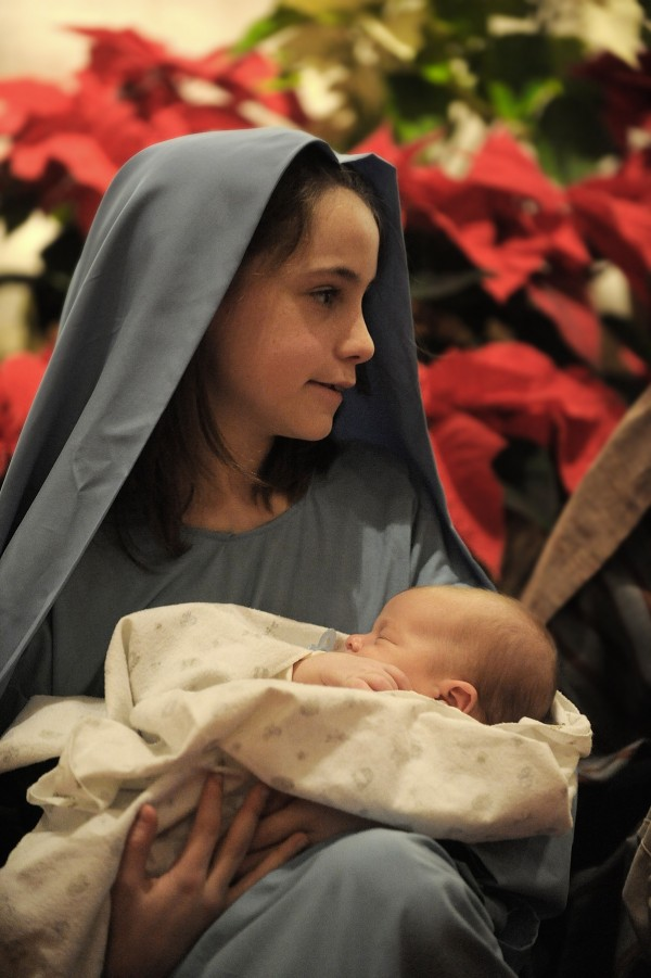 While singing &quotAway in a Manger&quot with other children, Mary (Michele Maybury of Brewer) holds the baby Jesus (William Whalen of Brewer) during Christmas Eve Mass at St. Joseph Catholic Church in Brewer in 2009.