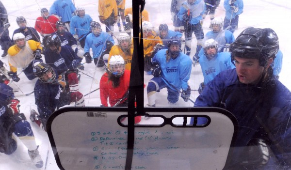 Maine Freeze Bantam Tier III team head coach Lance Ingerson (right) talks to players during practice at the Penobscot Ice Arena in Brewer on Thursday.
