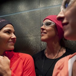Rachel Midgett of Houston, Texas, center, heads down to the start line with friends Laura Kopytkiewicz, left, and Ashley Paulsen to run in the half marathon of the Las Vegas Marathon in Las Vegas, in this photo taken Sunday, Dec. 4, 2011. Afflicted with breast cancer, Midgett has been taking the drug Afinitor for the last nine months and said that the cancer has not progressed in that time period, longer than other cancer drugs she has taken in the past.
