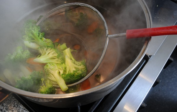 Blanched vegetables await mixing with chicken in the kitchen of Bich Nga Burrill in Winterport on Thursday, Dec 15, 2011. Burrill has written a new cookbook with recipes from her beloved country of Vietnam.