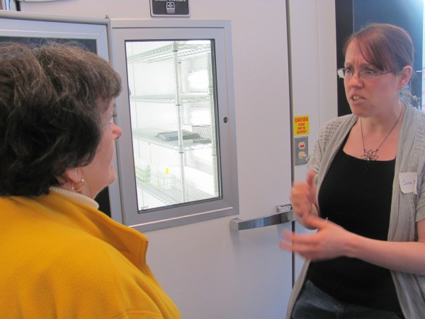 Carrie Schuman (right), an employee of Bigelow Laboratories, shows a visitor a climate-controlled room that will house the National Collection of Phytoplankton. Bigelow opened its new Center for Blue Biotechnology on Friday, Dec. 16, 2011.