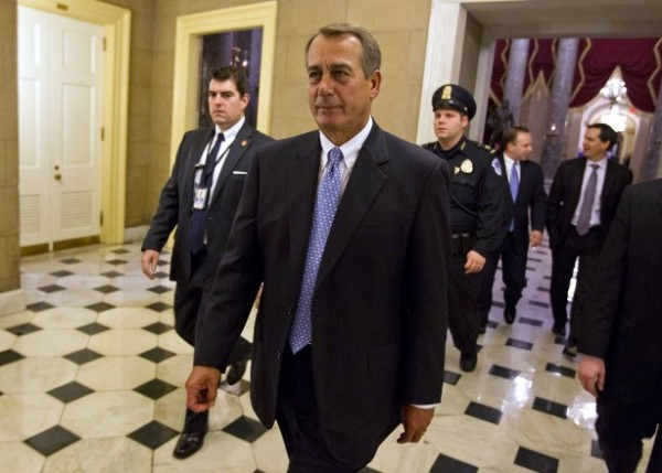 House Speaker John Boehner of Ohio walks of the floor of the House chamber on Tuesday, Dec. 20, 2011, in Washington. The House rejected legislation to extend a payroll tax cut and jobless benefits for two months, drawing a swift rebuke from President Barack Obama that Republicans were threatening higher taxes on 160 million workers on Jan. 1.
