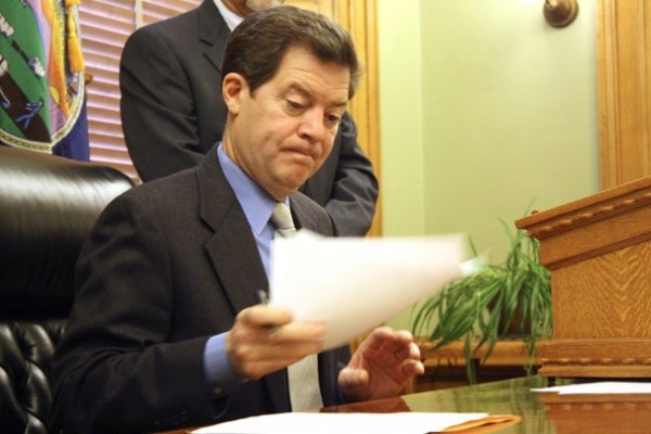 Gov. Sam Brownback of Kansas, who has served in the U.S. House of Representatives and the U.S. Senate, is carrying out a Tea Party plan in Kansas.