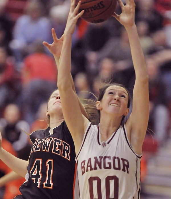 Bangor girl's basketball team player Katie Brochu (00) grabs a rebound away from Brewer player Deaven Smith (41) in the second half of their game in Bangor Thursday, Dec. 22, 2011.