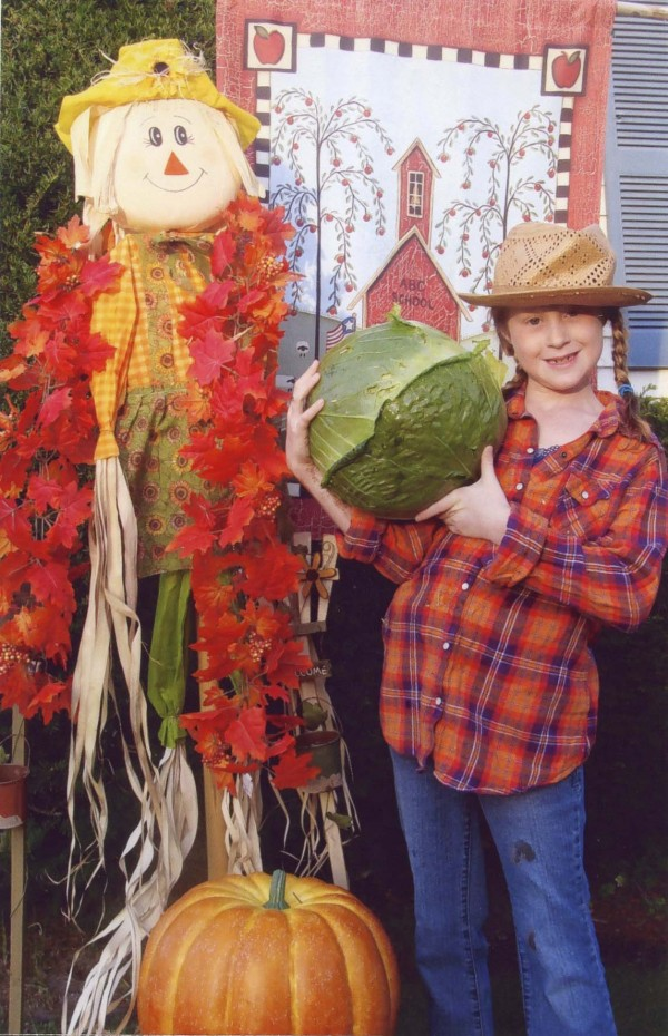 Bangor Christian Schools third-grader Madison Hobert holds up her award-winning over-sized cabbage that she grew in her backyard throughout the summer. For the 9.5-pound cabbage, Madison won a $1,000 scholarship from Bonnie Plants.